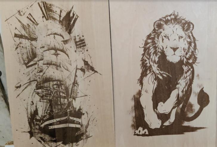 bateau et lion gravés au laser